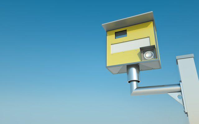 Traffic speed camera against blue sky. 3D render.